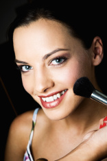 Makeup Brush and Smiling Woman