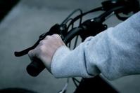 Hand on bicycle handle