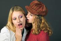 Young women gossiping