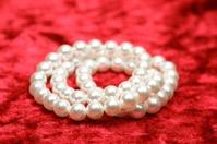 pearls on red velvet