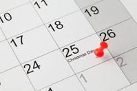 Red thumbtack on calendar