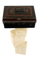 Old Metal Money Box On Pile Of Wooden Blocks