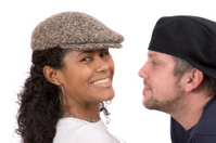 Diverse couple with hats