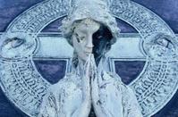 Statue in Prayer.