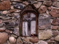 Christian Cross on a stone wall