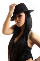 woman in black dress wearing cap
