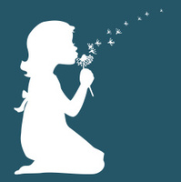 Girl making a wish and blowing dandelion flower