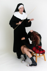 Girl getting in trouble by a nun.