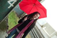 laughing woman holding umbrella rainy day