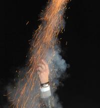 firework rocket launching from human hand