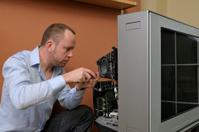 Tv Repair man with electronics