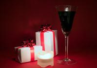 Wineglass and presents, christmas theme