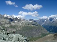 Alpine mountain valley with walker
