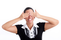 See no evil - businesswoman covering her eyes with hands