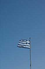 Greek flag against blue sky