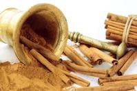 grinding cinnamon barks in montar