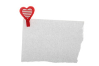 White notepaper with red heart