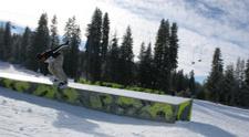 Snowboarder on  Rail