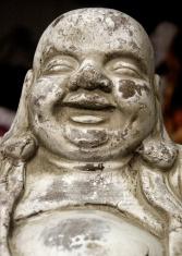 little happy Buddha in a garden