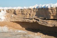 Frozen sand cliff