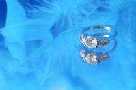 glamorous diamond ring and blue boa