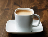 White square cup and saucer with coffee