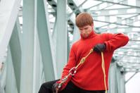 Man with equipment rope bridge