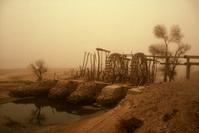 Ancient Chinese waterwheel in sandstorm