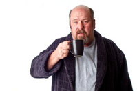 Man Drinking Coffee in Robe