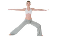 Young woman doing yoga, warrior / Virabhadrasana II position