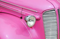 Classic Pink Hot Rod Car at a Public Show