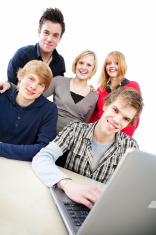 Group of students around laptop