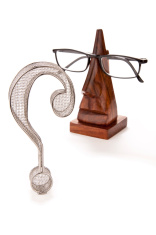 Question Mark with Reading Glasses on Stand