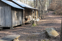 Wood cabin along mountain road