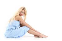 Blonde girl in a blue towel