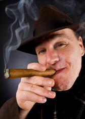 Mafia boss with cigar and a hat