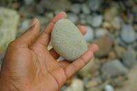 beach pebble in open hand