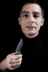 Man Holding Knife Blade
