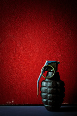 hand grenade on red background