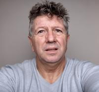 Mature man portrait bad hair day