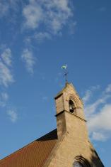 church bell tower against blue sky