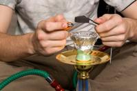 Lighting a hookah pipe