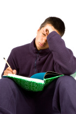 pakistan schoolboy is tired making homework