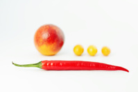Composition, red pepper and fruit