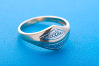 Gold ring on blue background