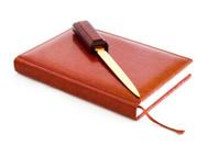 diary of skin, stationery knife, white background