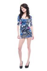 Brunette posing in blue dress