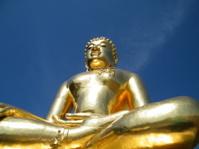 Golden meditating buddha