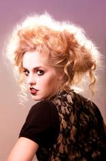 Caucasian model posing in a studio shot.