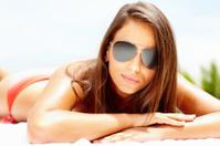 Cute woman wearing aviators and sunbathing